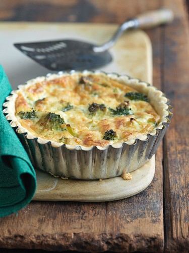 Broccoli and Cheese Mini Quiche on a Wooden Table