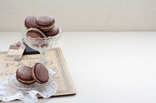 Chocolate macaroons filled with almond cream