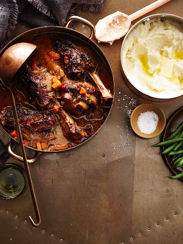 Braised honey-mustard leg of lamb with a side of mashed potatoes