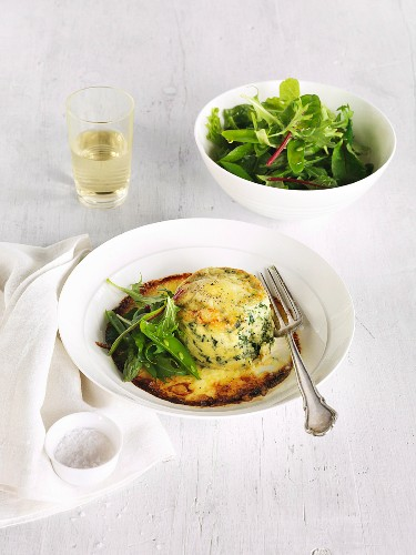 Double-baked cheese souffle with spinach