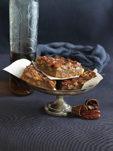 Pecan Bourbon Bars on a Small Metal Pedestal Dish