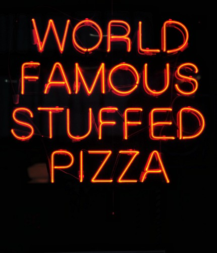 A neon sign on a pizzeria in Chicago
