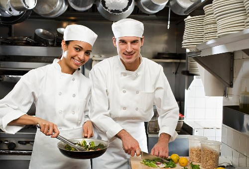 Male and female chefs in restaurant kitchen
