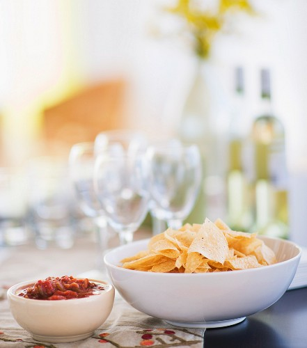 Table with snacks and wine glasses