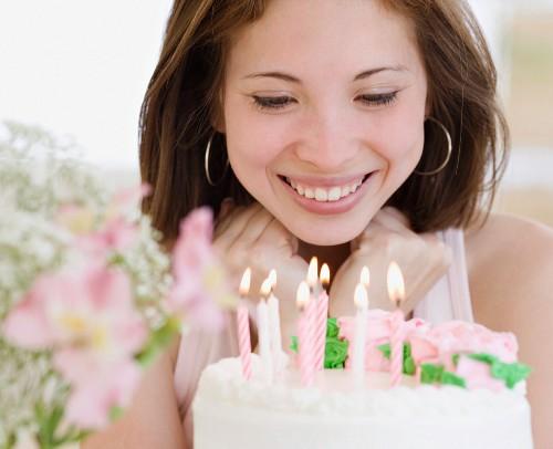 Woman smiling at birthday cake