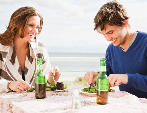 Couple eating at the beach