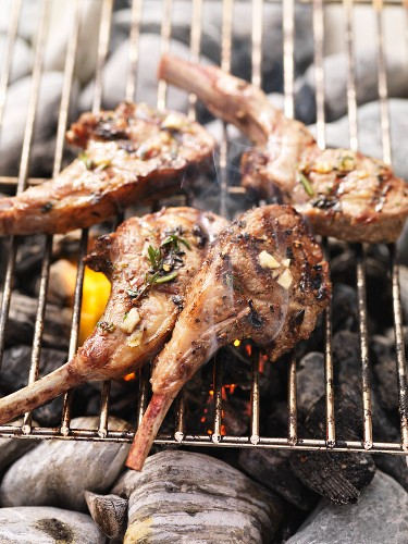 Barbecued lamb chops with rosemary on the barbecue