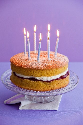 Victoria sponge with candles for a birthday