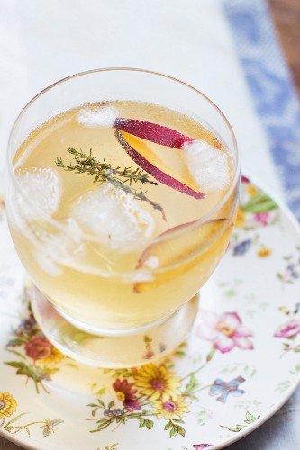 A summer cocktail with plum and thyme