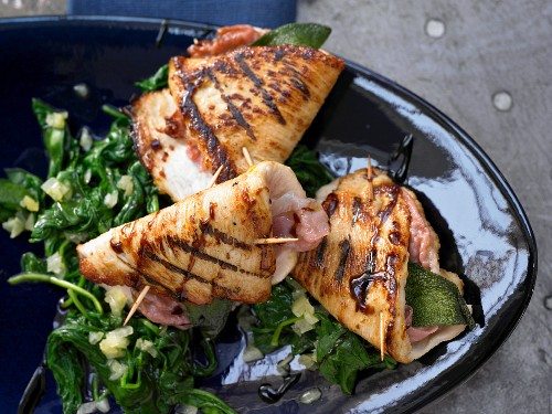 Stuffed turkey escalopes on a bed of leaf spinach