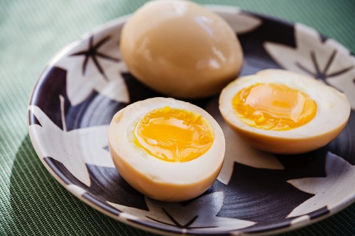 Marinated boiled eggs as a topping for Japanese ramen soup