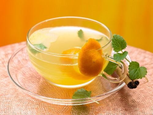 Lemon balm and cinnamon tea with orange juice