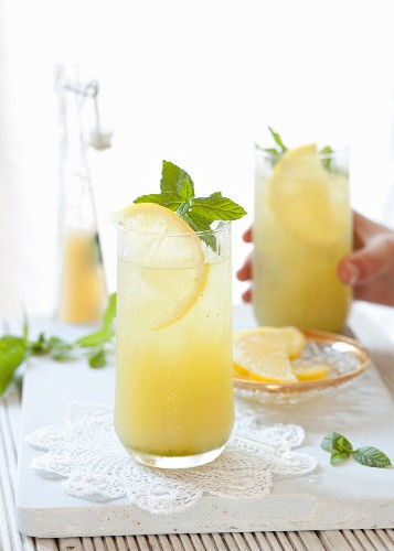 Apple and lemon juice with mint in glasses