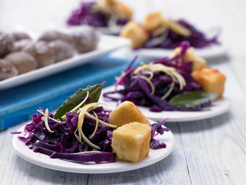 Breaded sheep cheese with lemon and red cabbage