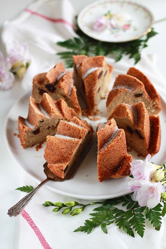 An apple purée Bundt cake with almonds and cherries