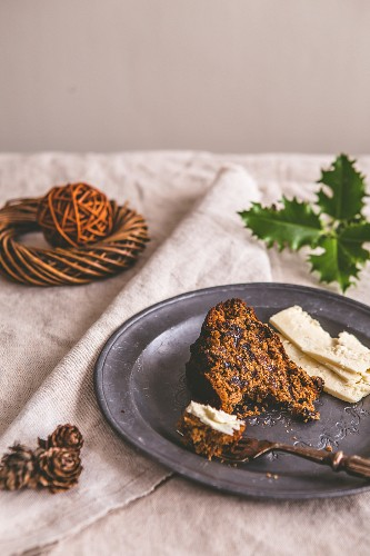 A slice of fruit cake served with Cheshire cheese