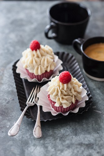 Vegan beetroot cupcakes with raspberries and vanilla frosting