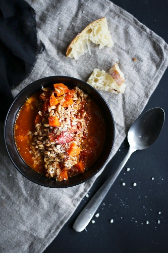 Tomato soup with farro, carrot and parmesan cheese