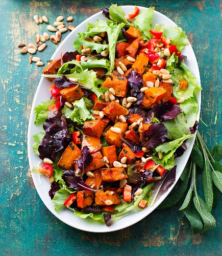 Warm pumpkin salad with pine nuts