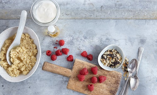 Ingredients for millet muesli with poppy seed and raspberries (seen from above)