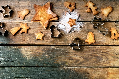 Homemade Christmas shortbread star shape sugar cookies with sugar powder and cookie cutters