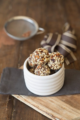 Vegan bliss balls with chopped almonds