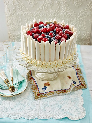 Meringue crown cake topped with berries