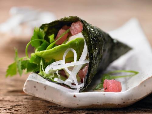 Temaki sushi with tuna tartar and avocado
