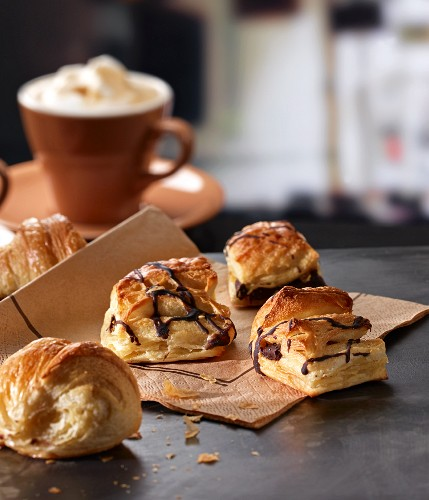 Pastries with chocolate and a latte in a cafe