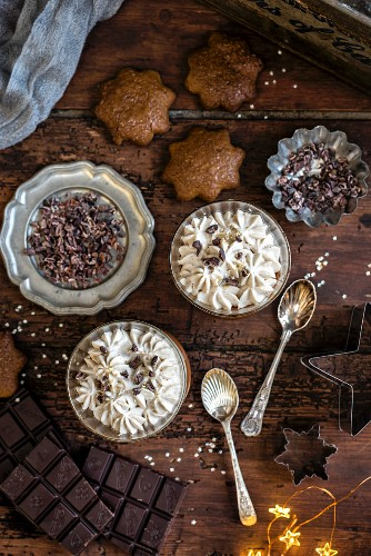 Vegan chocolate and coconut mousse made with aquafaba (chickpea brine) served with star-shaped gingerbread cookies