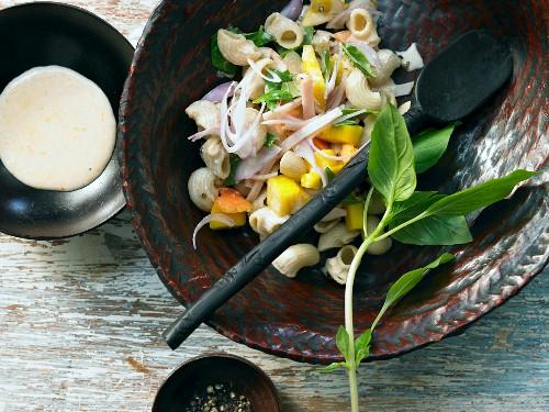Tropical pasta salad with chicken breast, mango and papaya