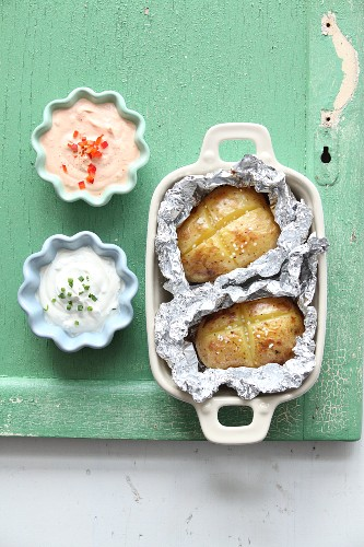 Potatoes in foil with two dips