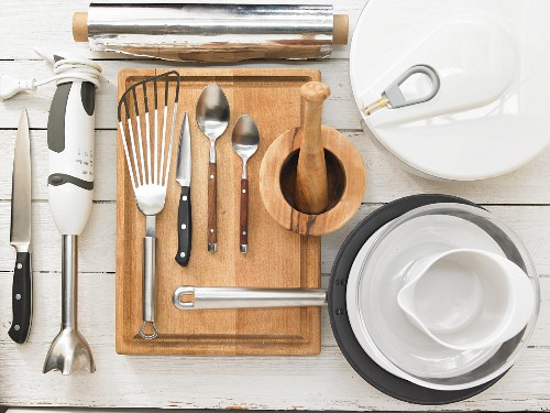 Kitchen utensils for the preparation of salad with beef filet and dressing