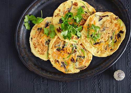 Small vegetable pancakes with wood ear mushrooms and shoots (Asia)