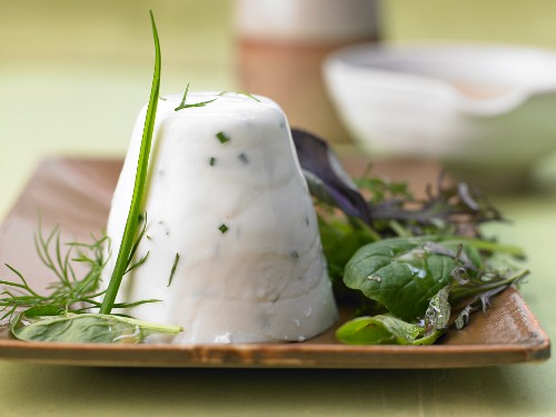 Quark, buttermilk and herb terrine with colorful salads and almonds