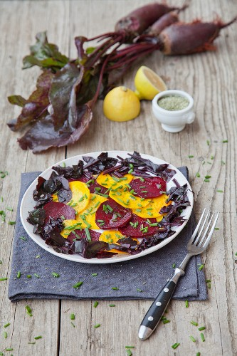 Beetroot carpaccio with beetroot leaves and chives