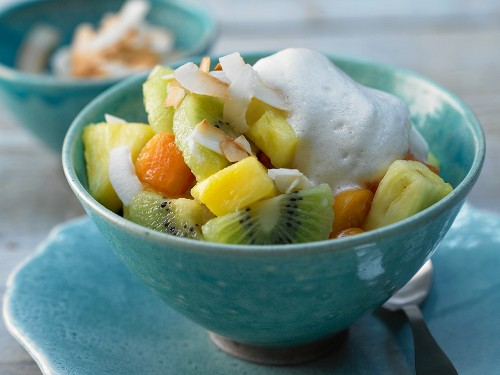 A tropical fruit salad with coconut and coconut yoghurt