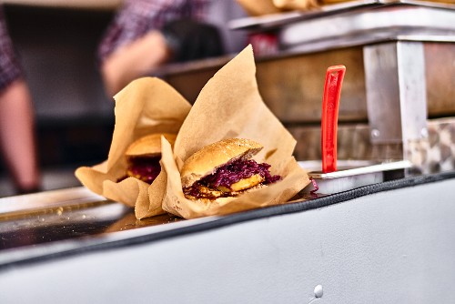 Sausages with red cabbage in a street kitchen