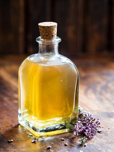 Homemade diy lavender and field horsetail (equisetum arvense) facial toner in a glass bottle