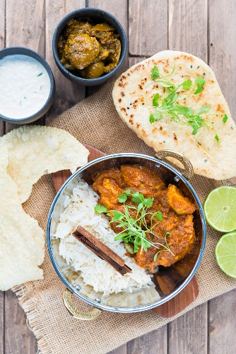 Chicken curry with Papadums in a balti dish