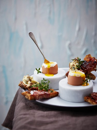 Soft-boiled eggs with ham, bread and porcini mushroom butter