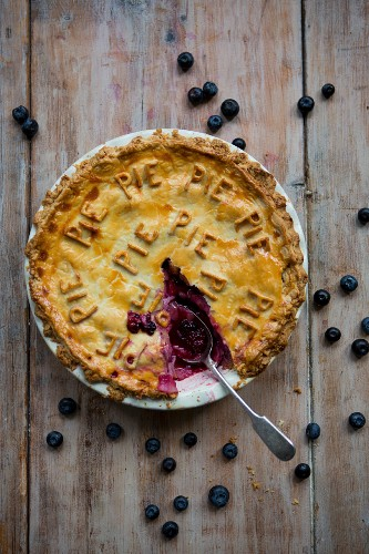 Fruit Pie with Slice Removed and Spoon