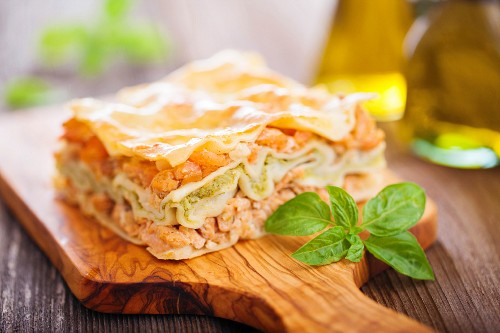 Fish and broccoli mousse lasagne on a wooden table