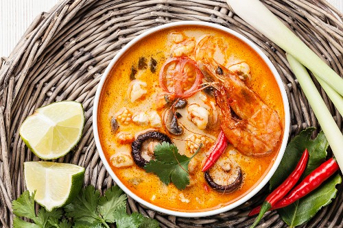 Spicy Thai soup Tom Yam with Coconut milk, Chili pepper and Seafood