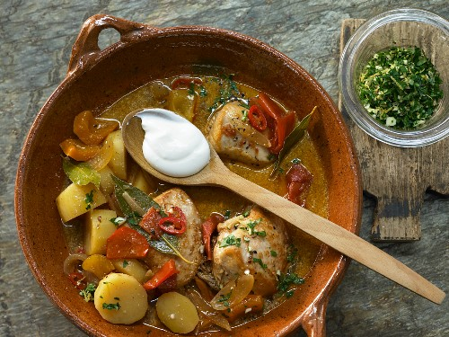 Chicken ragout with potatoes, peppers, chilli and sour cream (Hungary)
