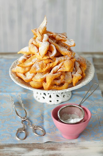 Faworki (Polish fried pastries) with icing sugar