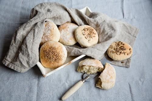 Spelt bread rolls on a linen cloth