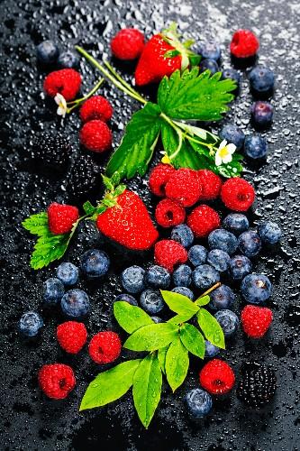 Fresh Berries on Dark Background: Strawberries, Raspberries and Blueberries