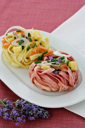 Colourful ribbon noodles with salmon, chives and onions