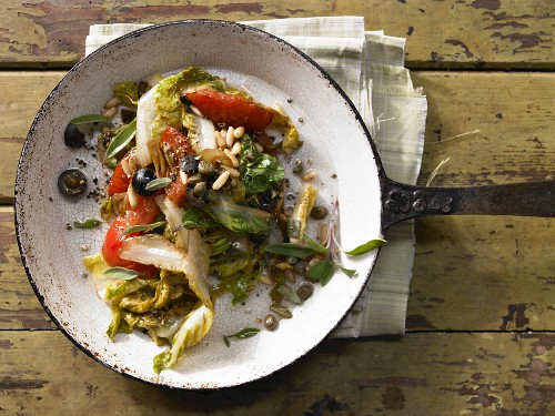 Braised romaine lettuce salad with tomatoes, olives and parmesan